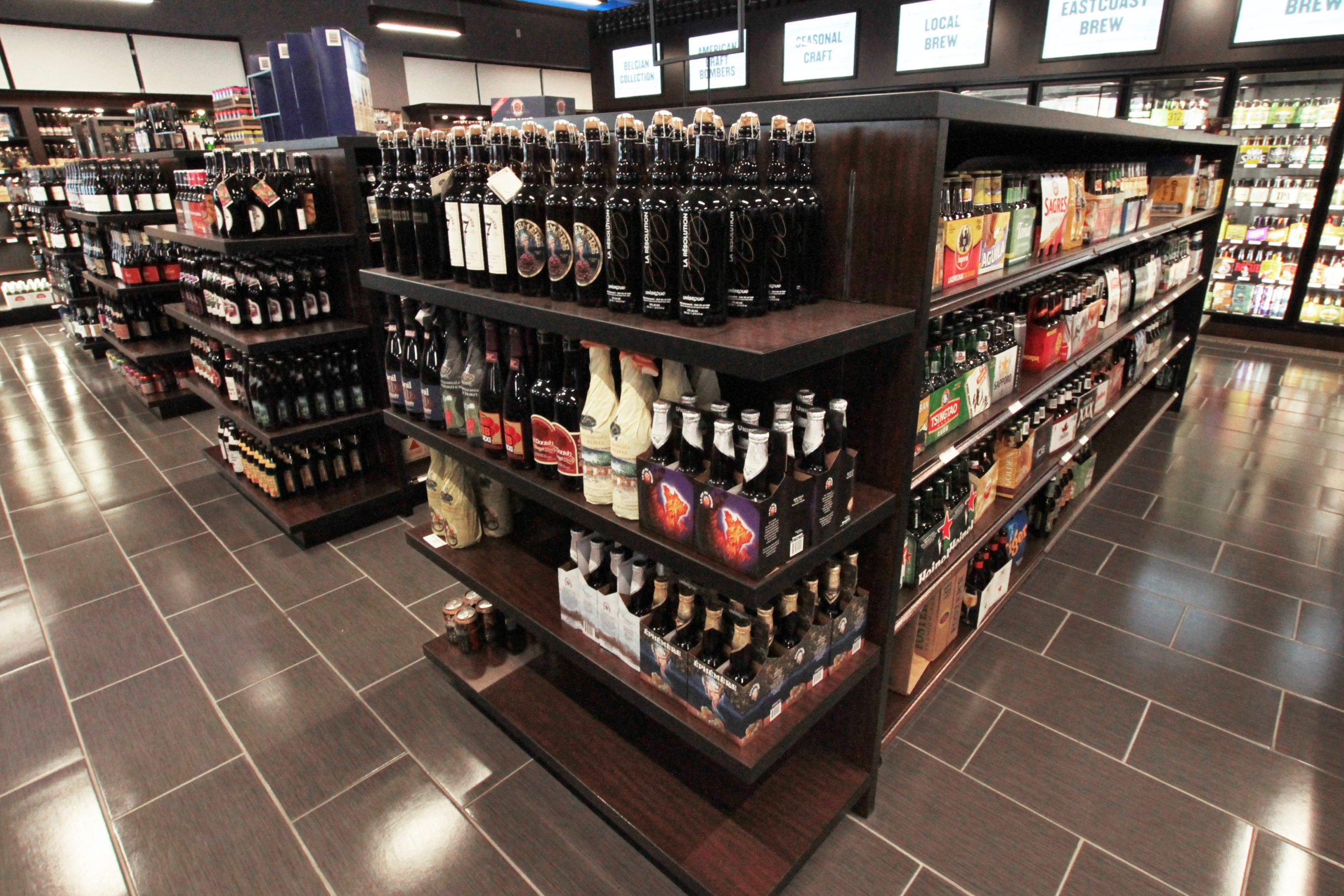 wine display, wood fixtures, retail display, signage, liquor display, gondola