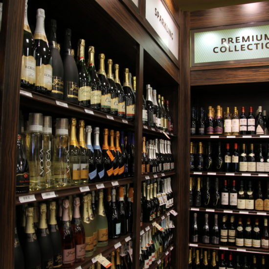 wine display, wood fixtures, retail display, signage, liquor display, gondola